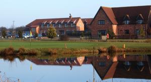 clubhouse, 12th green & cottage 1 Colmworth golf club